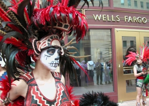 Aztec dancers open the protest outside Wells Fargo in Minneapolis.