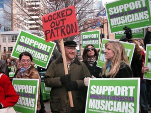 Nils Halker, a longtime orchestra patron from St. Paul, joins the locked-out musicians' rally in Peavey Plaza.