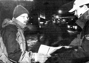 Tom Majeski (left),  a reporter for the Pioneer Press, distributed fliers outside the Xcel Energy Center  Jan. 14, 2003. About 50 members of the Minnesota Newspaper Guild, took part in the action to protest cuts sought by management during bargaining.