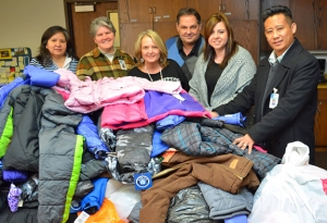 St. Paul Regional Labor Federation President Bobby Kasper (third from right) delivers more than 100 coats to staff at Project REACH, St. Paul Schools' homeless-outreach initiative.