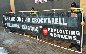 Members of the International Brotherhood of Electrical Workers man a banner outside the Lowry Building in St. Paul.