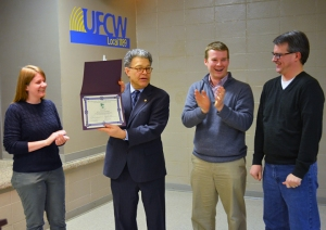 Sen. Al Franken cracks up the Minnesota Fair Trade Coalition leadership team while accepting his award. From L to R: coalition chair Kera Peterson, Franken, director Josh Wise and treasurer Russ Hess.