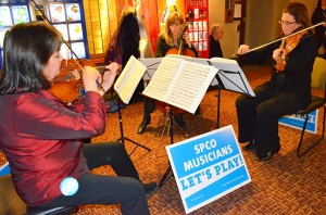 Musicians locked out by the St. Paul Chamber Orchestra perform an impromptu concert in the hall outside a Minnesota House committee hearing on lockouts.