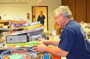 John O'Neil, president of United Steelworkers Local 264, sorts toys donated to Operation Christmas Solidarity.