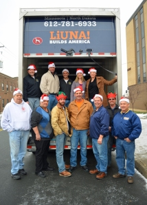 Helping load the Laborers Local 563 semi truck with Operation Christmas Solidarity donations are, L to R, (front) Frank Loffler, Bobby Kasper, Ryan Connelly, Dave Saunders, Dan McGowen, Mike Connelly, John O'Neil, (back) Mitch Nohrenberg, Mark Borowicz, Chris Peltier, Laura Wilson and Erica Dalager.