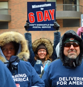 Advocates of preserving six-day mail delivery rally outside the main Minneapolis Post Office.