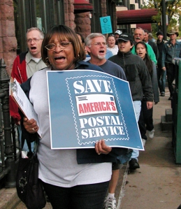 """Demonstrators marched in St. Paul during a """"Save Our Postal Service"""" rally on Cathedral Hill last year."""