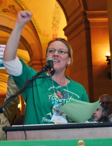 Lisa Thompson, president of Child Care Providers Together, an AFSCME Council 5 local, fires up the crowd in the Capitol rotunda during Council 5's annual lobbying day Feb. 26.