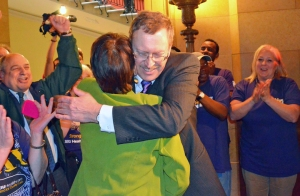 Authors of the legislation, Rep. Mike Nelson and Sen. Sandy Pappas, hug after the House vote.