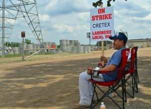Cretex worker Arturo Sanchez mans the picket line outside the company's Shakopee facility, where members of Laborers Local 563 are on strike to keep their defined-benefit retirement plan.