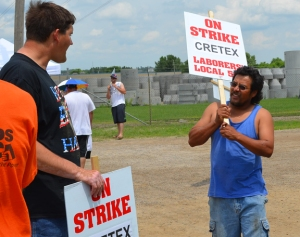 Members of Laborers Local 563 walk the picket line outside Cretex manufacturing in Shakopee.