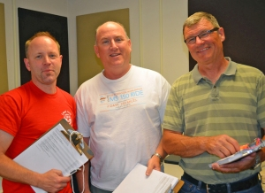 CWA members Tom Laabs, Dale Foster and Earl Moore prepare to knock doors in John Kline's district.