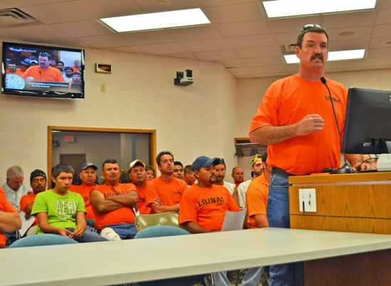 Backed by more than 50 supporters, Laborers Local 563 representative Tim Mackey asks Shakopee council members to help resolve the strike at Cretex's concrete manufacturing plant.