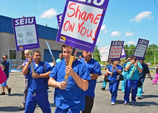 Workers, picketing outside Health Systems Cooperative Laundries today, show they are united behind efforts to win a fair contract.