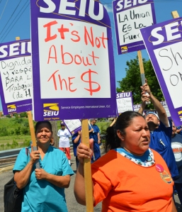 Negotiations between Workers United Local 150 and the laundry cooperative have stalled over language regarding work rules and workers' rights, the union says.