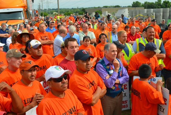 The rally drew more than 200 people to the picket line outside Cretex's Shakopee plant.