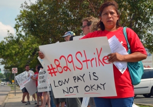 Angela Macario joins a demonstration in support of striking fast-food workers.
