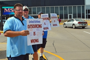 Machinists Local 1833 members picketing outside Terminal 1 today include (L to R) Derrick Bollea, A.J. Lindell and Greg Durand.