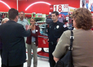 SEIU Local 284 President Keith Niemi talks to management and security staff in the West St. Paul SuperTarget.