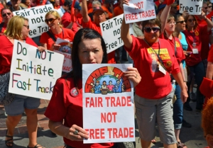 More than 200 people, many delegates to the CWA District 7 Convention, march along Nicollet Mall to a rally against fast-track approval of the Trans-Pacific Partnership trade agreement.
