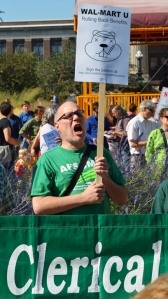 Randy Brooks, a library worker at the U of M and members of AFSCME Local 3937, joins the rally for affordable health care.