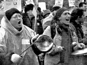 Linda Kingman (left) and Amy Zimmerman made sure they were heard during an Oct. 30, 2003 demonstration outside the University of Minnesota's Morrill Hall. Kingman was a striking AFSCME Local 3800 worker from the dentistry school; Zimmerman was a third-year student.