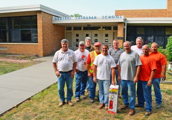 Union volunteers stand alongside the walkway to Central Lutheran School they helped construct in time for the start of fall classes. From L to R are Greg Johnson, Tom Reger, Frank Loeffler, Joe DeRasmi, Chris Peltier, Tim House, Gary Reed, Greg Massey, Tom Fox and Rick Maurer.