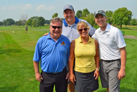 Terry Nelson, business manager and Secretary-Treasurer for IUPAT District Council 82, joins golfers from the Lockridge Grindal & Nauen law firm (L to R), Dan Larson, Karen Riebel and Andy Burmeister.