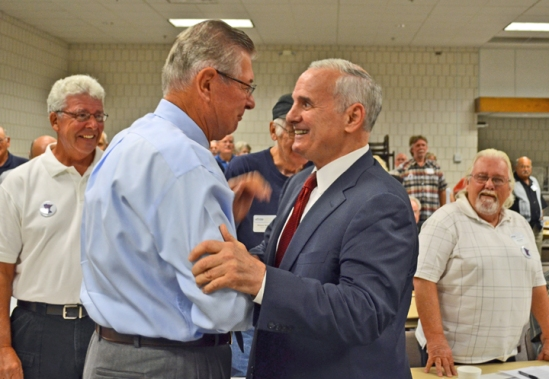 Gov. Mark Dayton (right) greets Minnesota AFL-CIO President Emeritus Bernard Brommer at the Minnesota State Retiree Council convention.