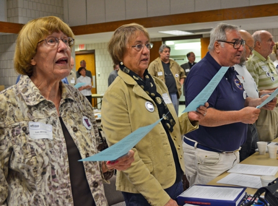 "Union retirees open their 17th convention with a singing of ""America the Beautiful"" at the Sheet Metal Workers Hall in Maplewood."