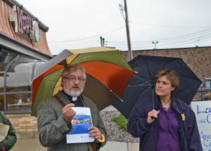 Rev. Grant Stevensen and SEIU Local 284 Executive Director Carol Nieters speak to activists outside a Wendy's in Minneapolis.