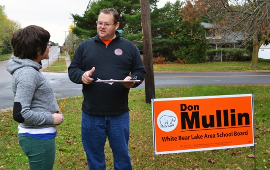 Don Mullin, a member of the Painters and Allied Trades, talks with a volunteer on his campaign for White Bear Lake School Board.
