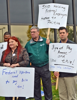 AFGE members Vicky Sirovy, Gary Schabert (middle) and Jared Thyen ask U.S. Rep. Erik Paulsen to end the federal government shutdown.