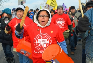 Members of the non-union worker group CTUL who clean area retail stores march in St. Paul. They picketed outside Target in Minneapolis earlier in the day.