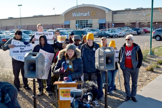 In a press conference outside the Midway Walmart, activists outline plans to protest low wages at big-box retail stores on Black Friday.