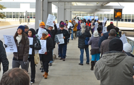 Airport workers and their supporters march outside Terminal 1 at Minneapolis-St. Paul International Airport during a week of action targeting low-wage employers.