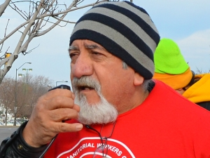 Enrique Barcenas, pictured while speaking at a Black Friday march in St. Paul, testified before the Legislature's Select Committee on Living Wage jobs.