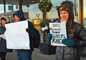 Jenny Warner, a parent of two students in the Minneapolis Public Schools, joins the demonstration outside the Education Summit.