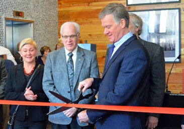 St. Paul Mayor Chris Coleman (right) and members of the City Council cut the ribbon at a grand opening celebration for The Penfield development.