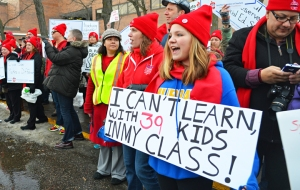 Supporters line the sidewalk outside St. Paul Public Schools headquarters during a rally in support of the teachers' contract campaign.