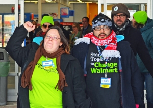 OUR Walmart members Cantaré Davunt and Gabe Teneyuque exit the Brooklyn Center Walmart after delivering a letter in support of fired associate April Williams.