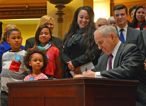 Surrounded by legislative supporters and members of the Raise the Wage Coalition, Minnesota Gov. Mark Dayton signed a bill increasing the minimum wage to $9.50 by 2016 – and indexing it to inflation.