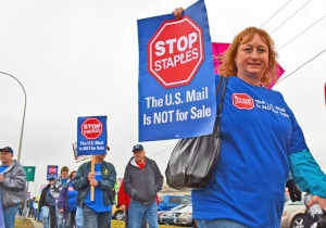Supporters of the Stop Staples campaign march outside the Roseville location during a nationwide day of action.
