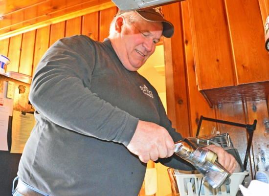 "Jerry Regenscheid, a member of St. Paul Plumbers Local 34, installed a new faucet for a St. Paul homeowner during the union's ""Water's Off"" day of service April 5."