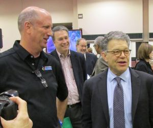 HealthWORKS Chair Jim Hynes (L) gives Sen. Al Franken a tour of the Health Fair after presenting the senator with the HealthWORKS Hero Award. (photo submitted)