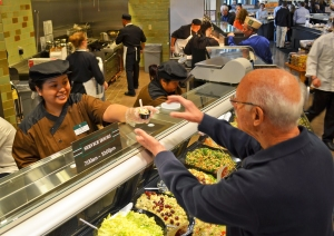 Bartara Gonzales serves a customer at the deli inside Lunds' downtown location.