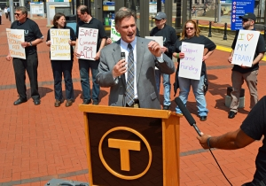 "Metro Transit GM Brian Lamb speaks during the ""Transit Tuesday"" rally, which took place next to the Government Plaza light-rail stop."