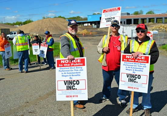 Members of IBEW Local 110 picket the non-union entrance to the construction site of Forest Lake's new City Hall. Picketing, from L to R, are Gary Kispert, Mike Finamore and John Vejtruba.