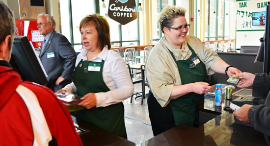 UFCW Local 1189 members Diane Kramer (L) and Jillian Roemer ring up the first two customers on Lunds' first day open for business downtown St. Paul.