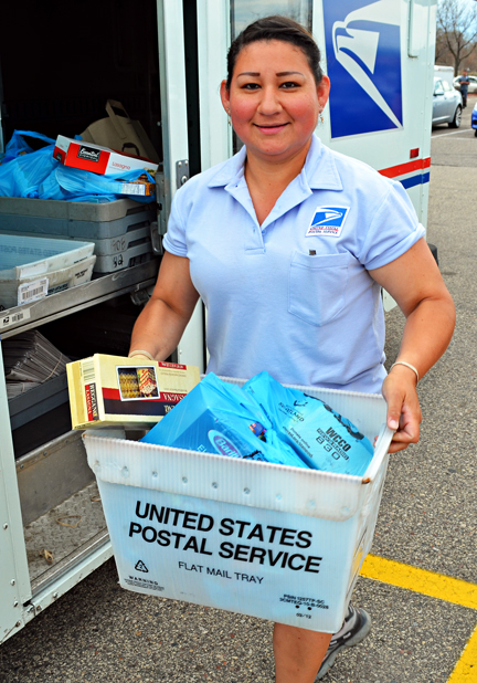 Claudia Espino, a member of St. Paul Letter Carriers Branch 28, dropped off food at the distribution site in Sun Ray Cub Foods' parking lot.